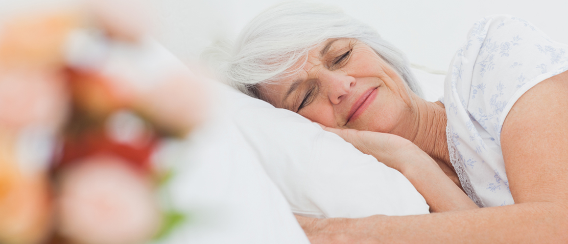elderly woman laying down getting rest