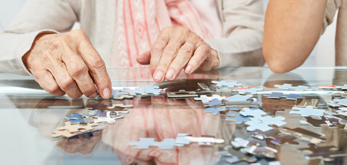 Senior woman participates in a mind-engaging activity.