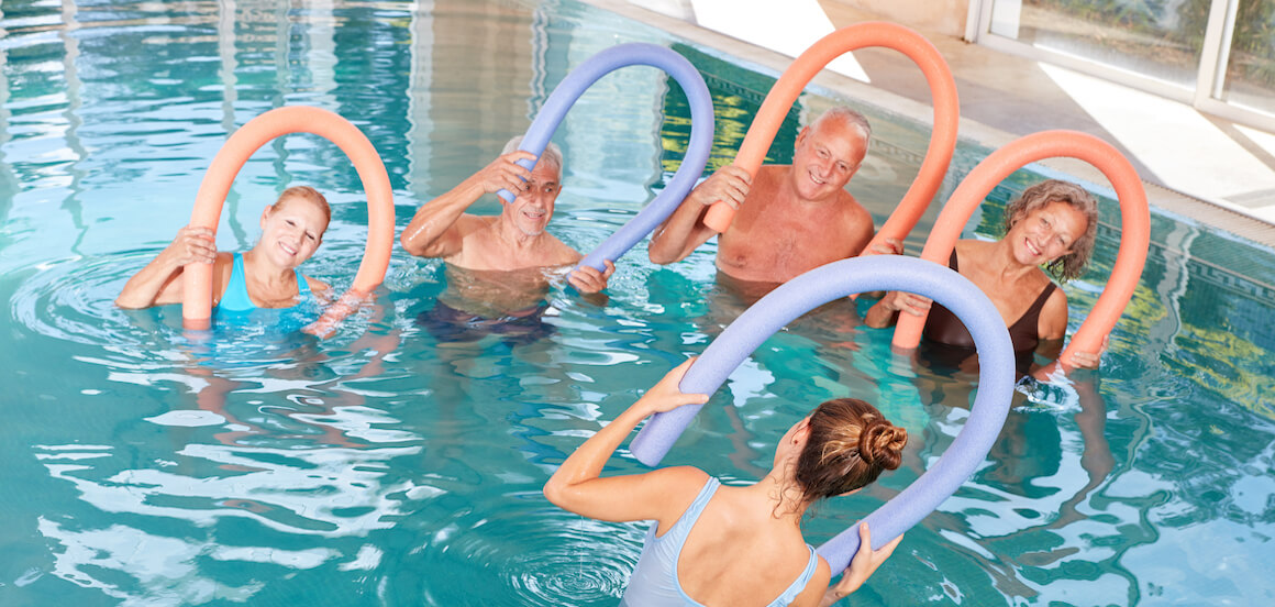 Group of seniors participate in a group aquatic exercise class.