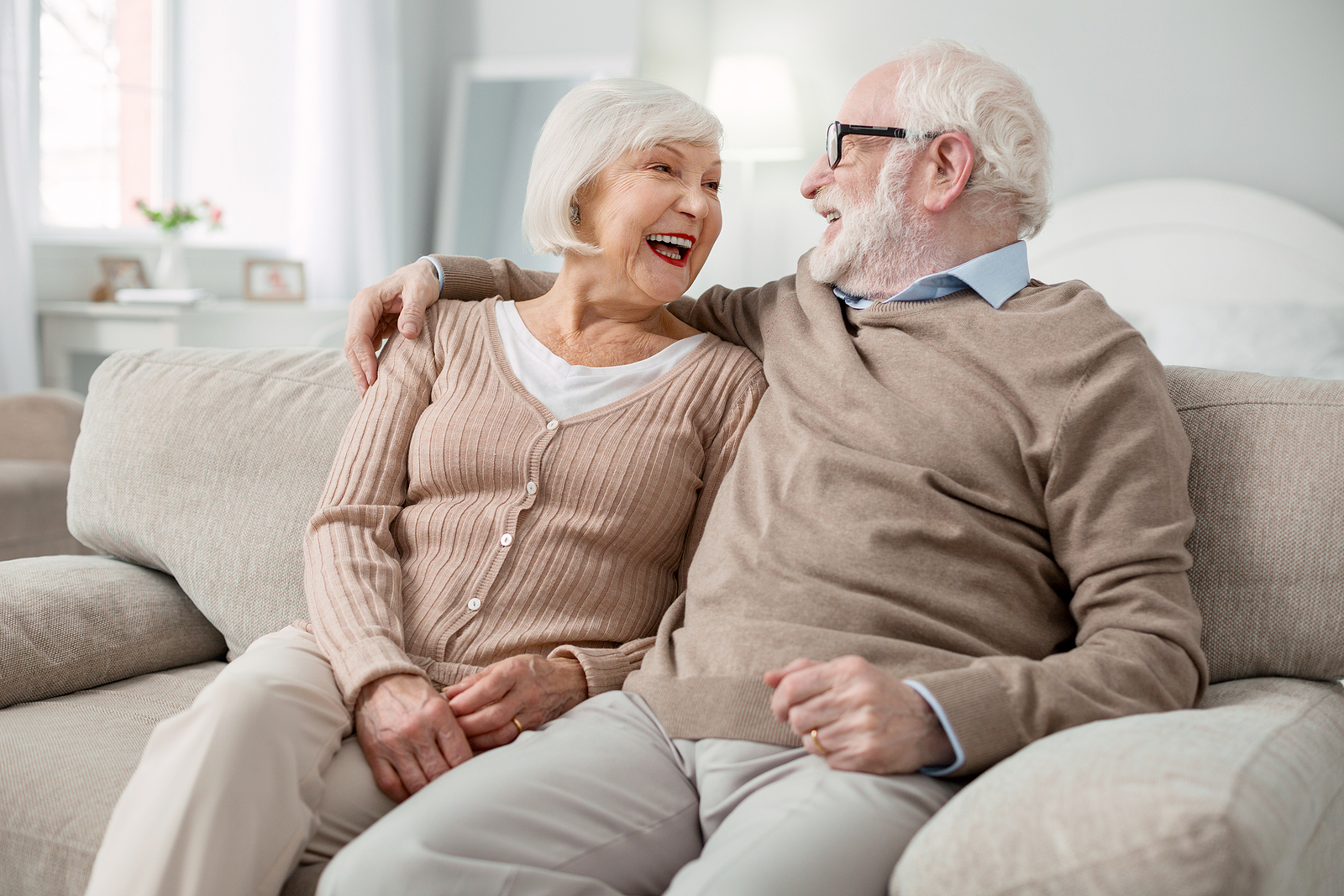 Happy senior couple enjoys each other's company in an assisted living community.