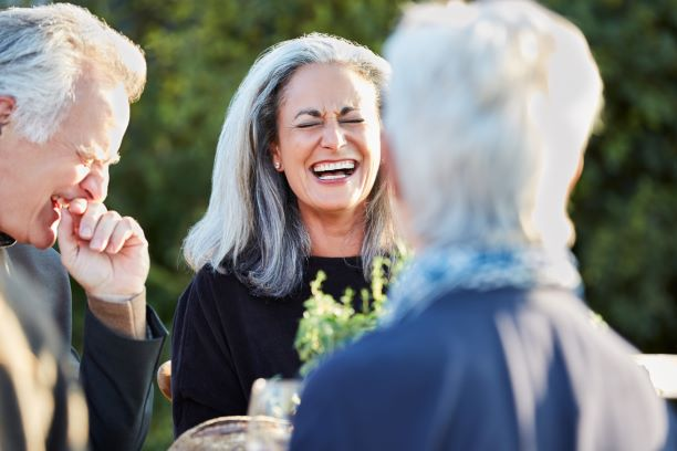 senior woman laughing with friends