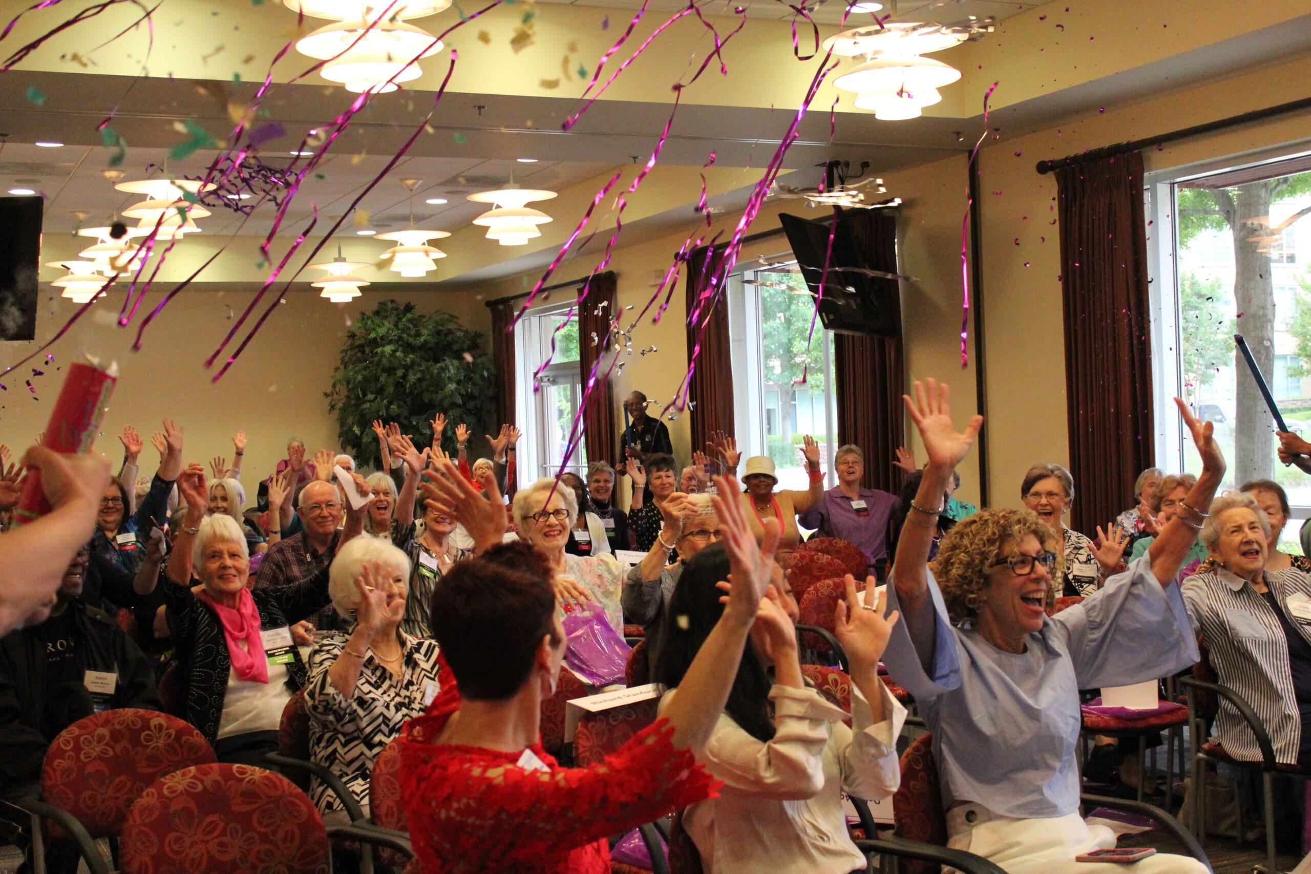 seniors celebrating with confetti at CC Young senior living